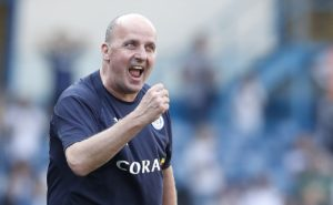 Wigan manager Paul Cook hailed his players for overcoming their poor away record to finish comfortably clear of the relegation zone.