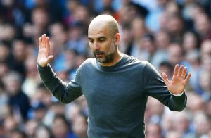 Manchester City boss Pep Guardiola is thriving on the pressure of the title race, according to Leicester City counterpart Brendan Rodgers.