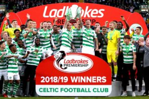 Celtic were presented with the Ladbrokes Premiership title for an eighth consecutive season after a2-1 victory over Hearts on Sunday.