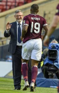 Hearts will be without Uche Ikpeazu and Peter Haring when they face Aberdeen on Friday night.