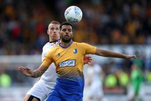 Mansfield midfielder Jacob Mellis has verbally agreed to stay at the club next season, according to new manager John Dempster.