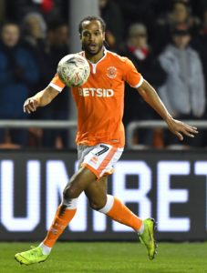 Blackpool forward Nathan Delfouneso has signed a new two-year deal with the Sky Bet League One club.