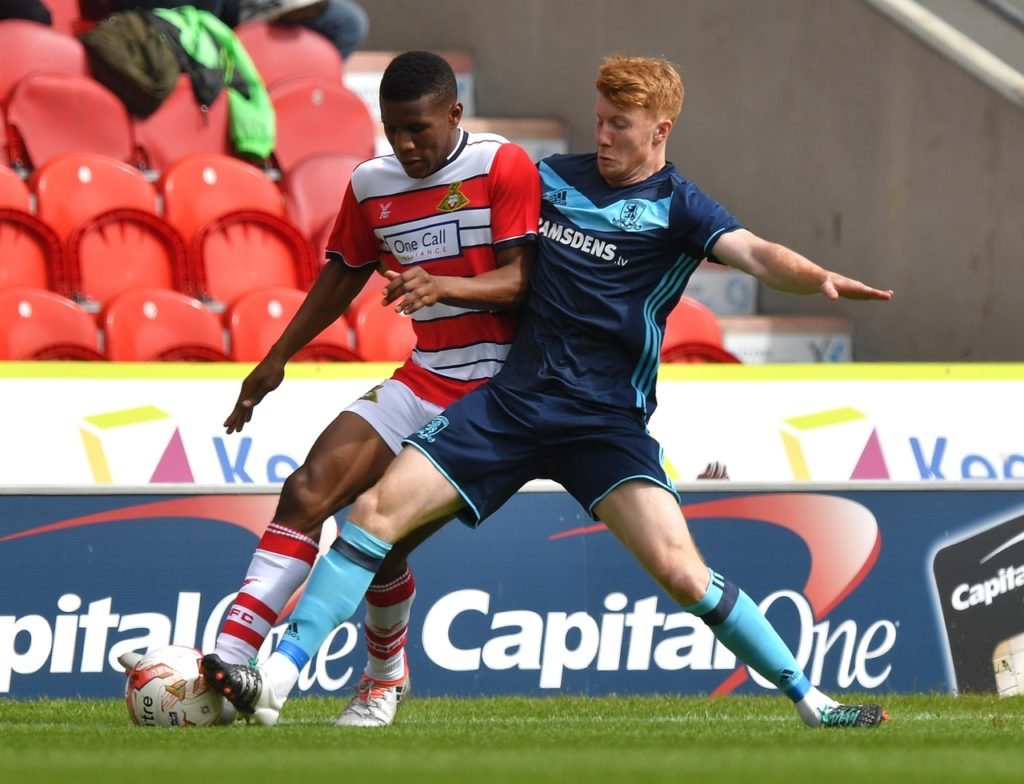 Doncaster have announced the signing of Cambridge full-back Brad Halliday on a two-year contract.