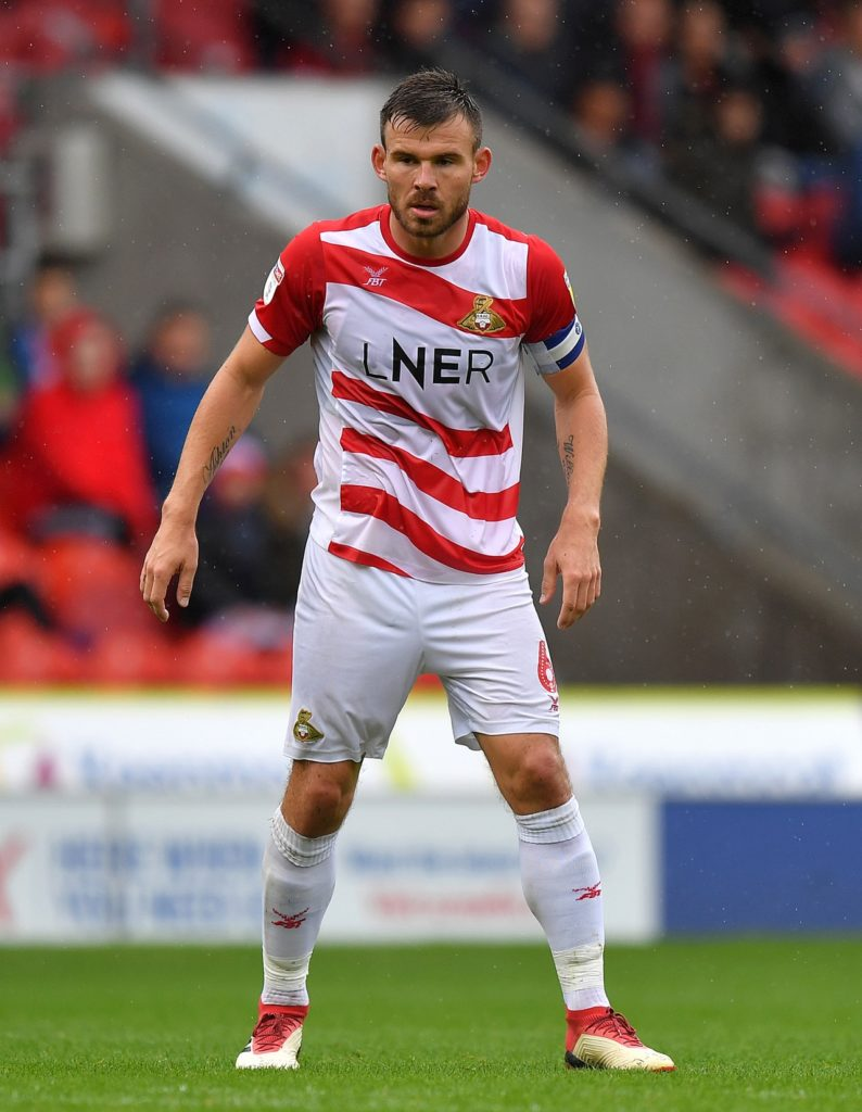 Scunthorpe have re-signed Doncaster defender Andy Butler on a one-year contract.