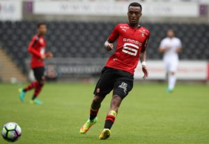 Rennes defender Edson Mexer is a target for Scottish club Rangers and they have invited him to attend Sunday's Old Firm clash with Celtic.