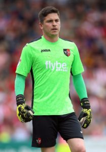 Goalkeeper Christy Pym will join Peterborough when his Exeter contract expires.