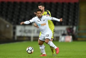 Swansea winger Wayne Routledge has signed a one-year extension with the Championship club.