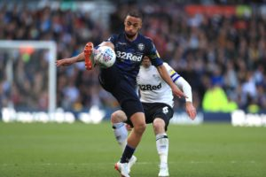 Kemar Roofe hit a second-half winner to give Leeds a slender 1-0 advantage over Derby following the first leg of their Sky Bet Championship play-off semi-final.