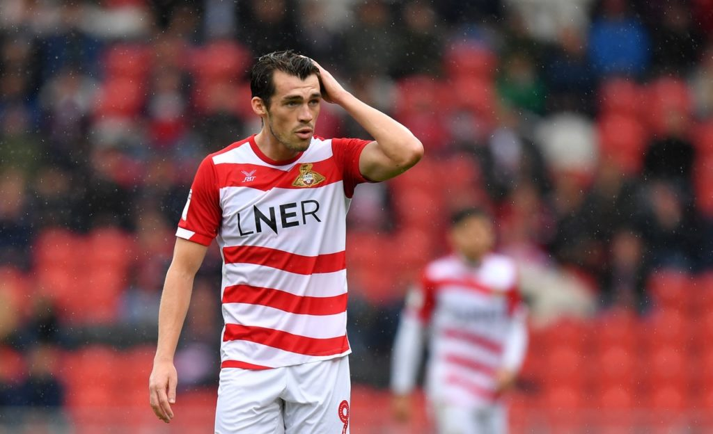 Doncaster booked their place in the Sky Bet League One play-offs with a hard fought 2-0 win over Coventry.
