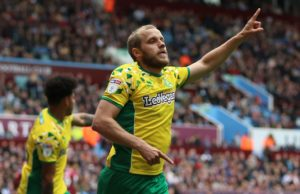 Norwich clinched the Sky Bet Championship title after a 2-1 win against play-off bound Aston Villa at Villa Park.