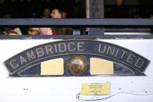 Cambridge have signed midfielder Luke Hannant following his release from Port Vale.
