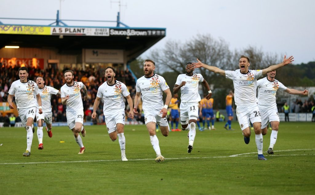 Delighted Newport boss Michael Flynn has challenged his underdogs to go one step further after reaching the Sky Bet League Two play-off final.