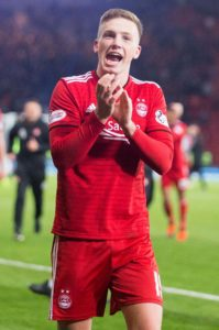Second-half strikes from Lewis Ferguson and Greg Stewart helped Aberdeen dig out a hard-fought 2-1 win over Hearts.