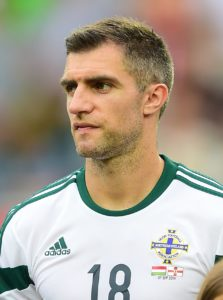 Northern Ireland defender Aaron Hughes leads the first batch of Hearts first-team players heading for the Tynecastle exit door this summer.