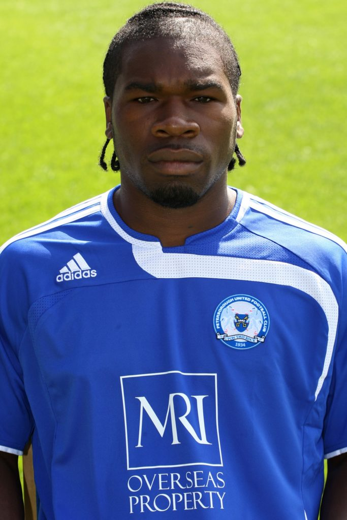Former Peterborough forward Aaron Mclean has signed a three-year contract as the club's first-team coach.
