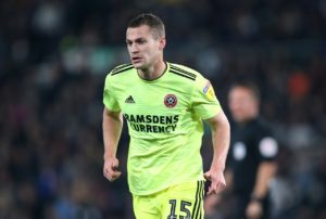 Paul Coutts and Martin Cranie are among 12 players released or transfer-listed by Sheffield United as they prepare for the Premier League.