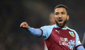 Burnley have confirmed Aaron Lennon will stay at the club for another season, while three first-team players have been released.