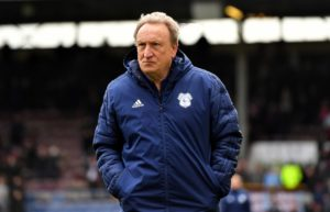 Cardiff boss Neil Warnock hails new boy Vassell.