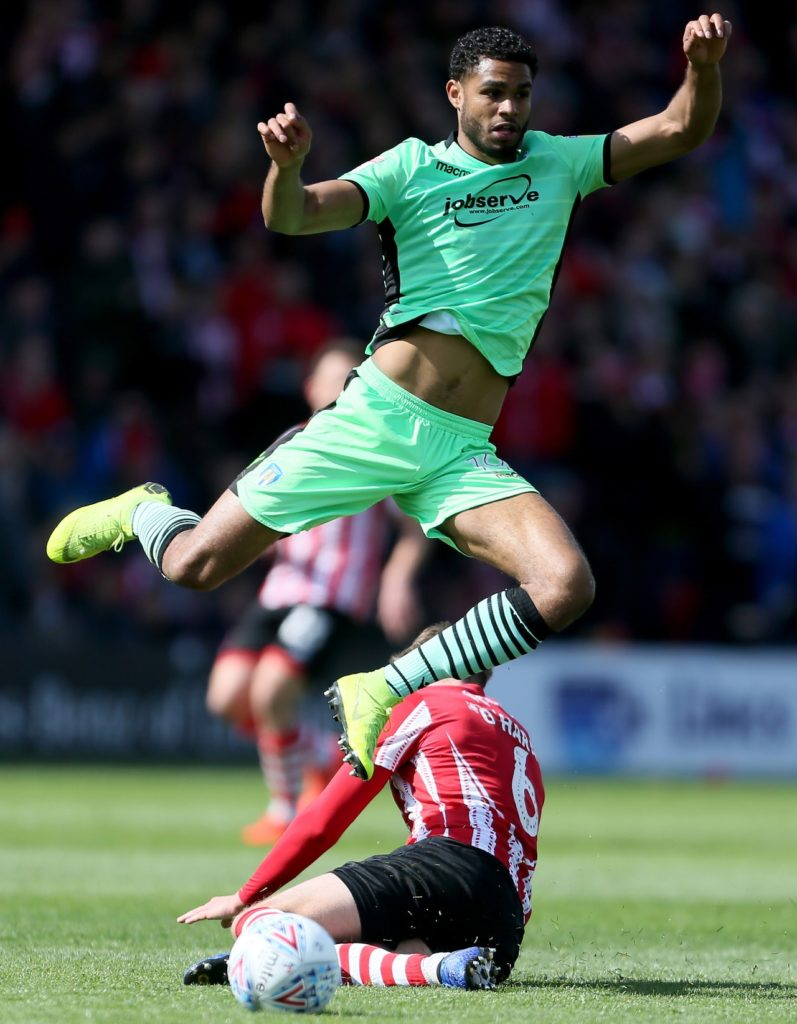 Striker Mikael Mandron is seeking his fifth club after being released by Sky Bet League Two Colchester United.
