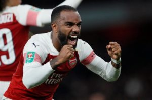 Barcelona target Alexandre Lacazette says he is flattered over rumours linking him with a move to the Nou Camp but is happy with Arsenal for now.