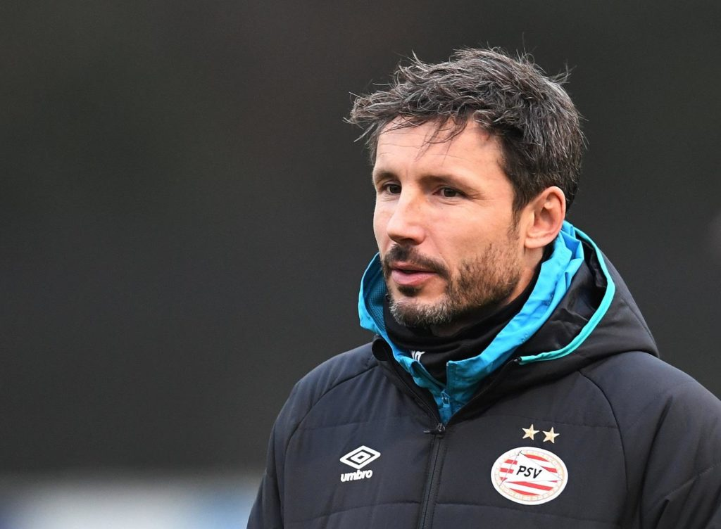 PSV boss Mark van Bommel says Ajax are still favourites to win the title but stressed his side will not give up.