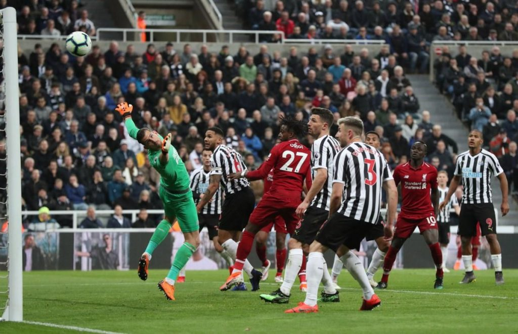 Liverpool kept their title hopes alive with a 3-2 win at Newcastle thanks to Divock Origi's 86th minute header.