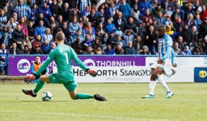 Manchester United's Premier League top-four hopes were ended following a disappointing 1-1 draw at relegated Huddersfield Town.