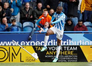 Isaac Mbenza will remain a Huddersfield player next season as the club have taken up their option to make his loan move permanent.