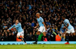 Vincent Kompany's magnificent strike put Manchester City to within one victory of defending their title after a 1-0 win over Leicester.
