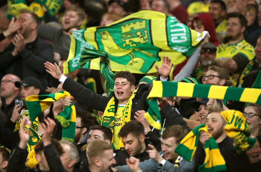 Norwich will meet with fan group representatives to tackle issues raised by a new membership scheme which has been labelled as a 'tax on loyalty'.