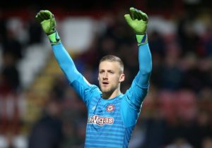Bristol City have completed the signing of goalkeeper Daniel Bentley from SkyBet Championship rivals Brentford.