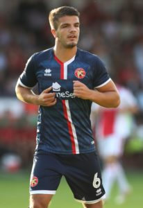 Morecambe have signed former England Under-17 player Tom Brewitt.