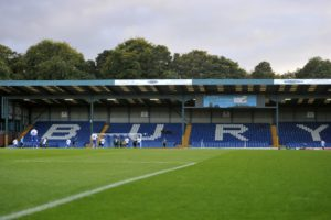 A bid by tax officials to wind up newly-promoted League One football club Bury has been adjourned.