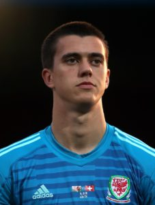 Wigan goalkeeper Owen Evans has signed a new two-year deal with the club.