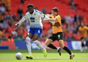 Tranmere defender Manny Monthe has signed a new two-year deal with the club.