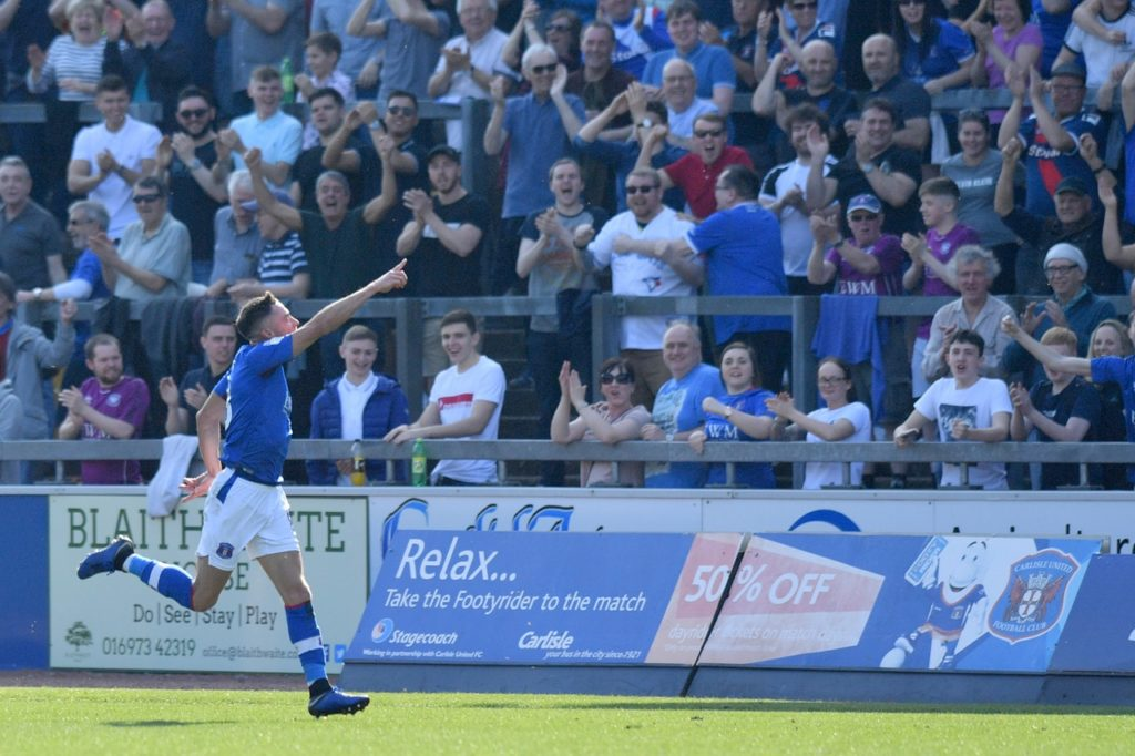 Mike Jones is targeting promotion with Carlisle after agreeing a new one-year contract.