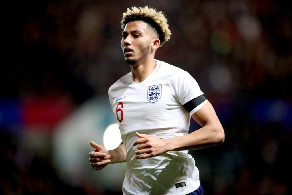 Lloyd Kelly has credited his foster care upbringing with helping him fulfil his international dreams.