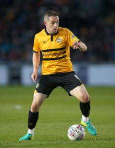 Newport midfielder Matty Dolan has signed a two-year contract extension with the Exiles.
