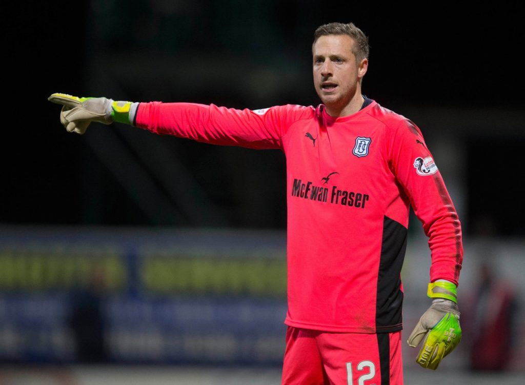 Elliott Parish has vowed to challenge Zander Clark for the St Johnstone number one spot after completing a move to Perth.