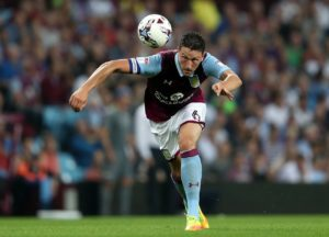 Huddersfield have completed the signing of defender Tommy Elphick on a free transfer following his release by Aston Villa.
