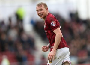 Northampton have re-signed winger Nicky Adams following his departure from Bury.