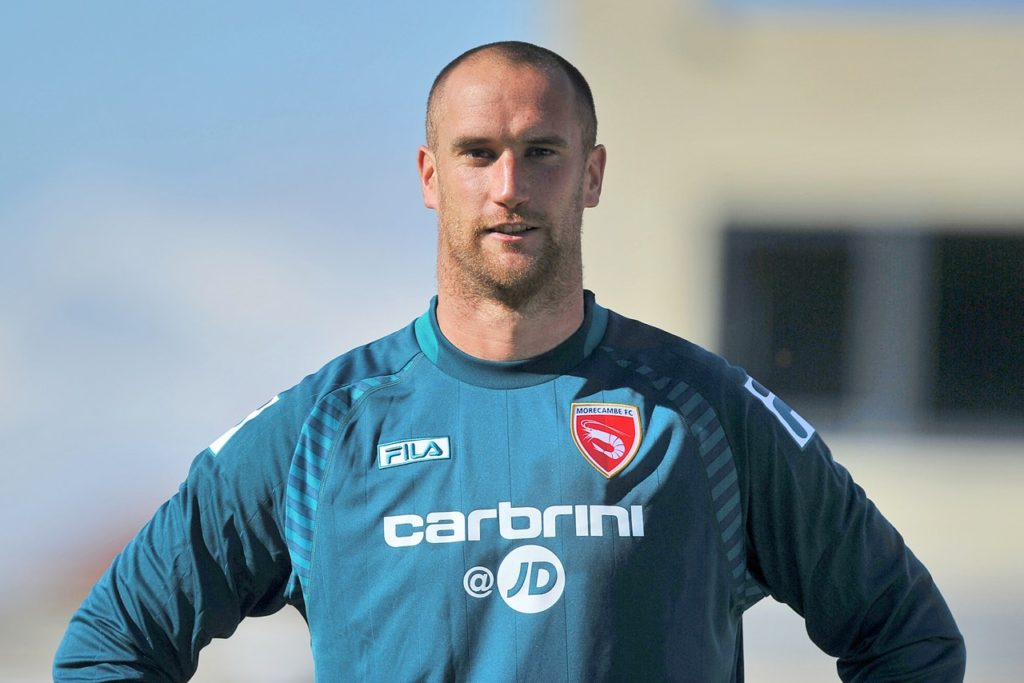 Goalkeeper Barry Roche has signed a new one-year deal with Morecambe.