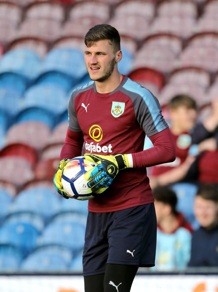 Goalkeeper Conor Mitchell has joined NIFL Premiership club Larne on a free transfer after his contract with Burnley expired.