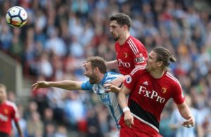 Watford defender Craig Cathcart claims he feels 'at home' after signing a new four-year contract at Vicarage Road.