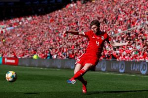 Ben Davies is hoping Wales' younger players will grow up quickly in international football in order to reach Euro 2020 next summer.
