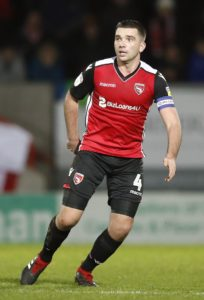 Midfielder Alex Kenyon has signed on for another season with Sky Bet League Two Morecambe.