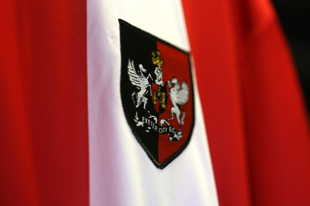 Exeter have completed a move for teenage Gloucester City defender Noah Smerdon, the League Two club has announced.