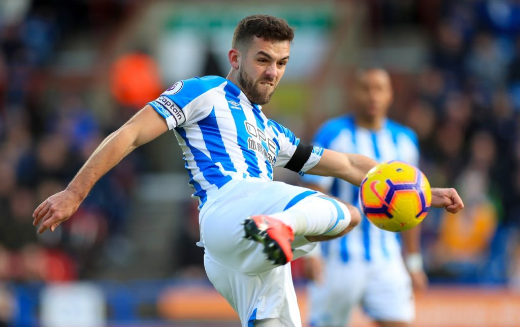 Stoke have signed defender Tommy Smith from Huddersfield for an undisclosed fee.