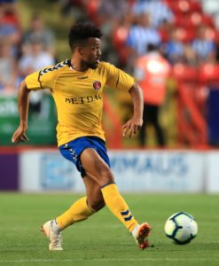 Striker Nicky Ajose has signed for Exeter after helping two clubs in their promotion bids last season.
