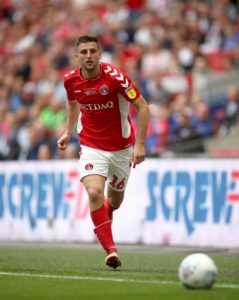 Ben Purrington has rejoined Charlton on a permanent three-year deal from Rotherham following a successful loan spell last season.